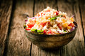 Savory quinoa with herbs peppers and tomato heaped rustic bowl of for a healthy vegetarian dish rich in protein nutrients Royalty Free Stock Photos