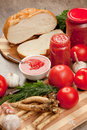 Savory tomato garlic and horseradish ingredients for its manufacture Royalty Free Stock Photography