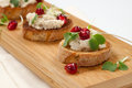 Savory tuna salad crostini wooden tray with three on white Stock Photos