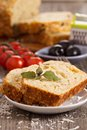 Savoury loaf cake with tomatoes cheese and olives Stock Photography