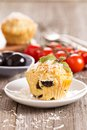 Savoury muffins with parmesan cheese and olives Stock Photography