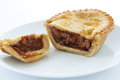 Savoury pie meat with a beef filling on a white plate Royalty Free Stock Image