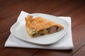Savoury pie torta salata with vegetables on wooden table Stock Photo