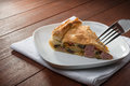 Savoury pie torta salata with vegetables on wooden table Royalty Free Stock Photos