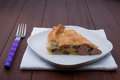 Savoury pie torta salata with vegetables on wooden table Stock Photos