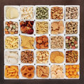 Savoury snack selection large food in square porcelain bowls Royalty Free Stock Image