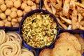 Savoury snacks chakli chana chor garam mathri sakhe kachori matthi namak parei these are served with tea Stock Photo