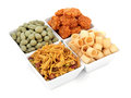 Savoury snacks snack party food selection in square porcelain bowls over white background Stock Photography