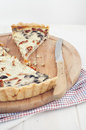 Savoury tart on wooden board Stock Photo