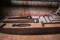 Saws, sickles, hammer and other devices on the bloody floor in b Royalty Free Stock Photo