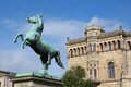 Saxon steed and leibniz university in hannover bronze statue of the front of germany Royalty Free Stock Photos