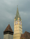 Saxon tower clock closeup in medias romania on dark sky and cl medieval german lutheran church of detail of the Royalty Free Stock Photos
