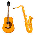 Saxophone and acoustic guitar. Royalty Free Stock Photo