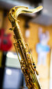 Saxophone closeup with golden keys over a colorful blurred background Stock Images