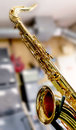 Saxophone closeup with golden keys over a colorful blurred background Stock Photos