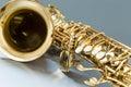 Saxophone on the gray background Stock Photo