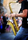 Saxophone player is in the street Royalty Free Stock Images