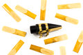 Saxophone reed mouthpiece reeds and on the white background Royalty Free Stock Photo