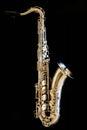 Saxophone tenor. Woodwind Classical Instrument. Jazz, blues, classics. Music. Saxophone on a black background. Black mirror surfac Royalty Free Stock Photo