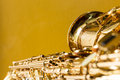 Saxophone on the yellow background Royalty Free Stock Photos