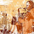 Saxophonist on a grunge background Stock Photo