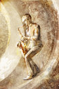Saxophonist, jazz musician on the retro background Stock Images