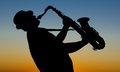 Saxophonist at sunrise on sunday morning Royalty Free Stock Photo