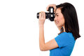 Say cheese smile please professional female fashion photographer taking a snapshot Stock Images