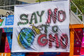 Say no to gmo sign at anti gmo rally in asheville nc may close up of a colorful saying showing a bee and planet earth an monsanto Royalty Free Stock Photos