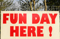 A saying in red sign fun day here today Royalty Free Stock Image