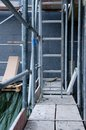 Scaffold steel next to house wall with polystyrene Royalty Free Stock Photo