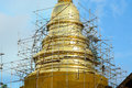 Scaffold structure in construction site between renovate golden pagoda chiangmai thailand Royalty Free Stock Photo