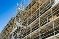 Scaffolding against a building with blue sky Stock Photos