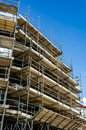 Scaffolding against a building with blue sky Royalty Free Stock Photo