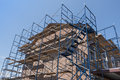 Scaffolding on brick building exterior of Royalty Free Stock Image