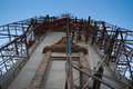 scaffolding for buddhism church construction with moon at evening Royalty Free Stock Photo