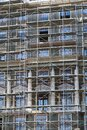 Scaffolding at the facade of a building under construction, multi-storey building, without people Royalty Free Stock Photo