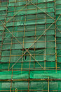 Scaffolding and green netting abstract backgground Stock Image