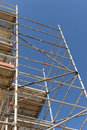 Scaffolding low angle view of tall with blue sky background Stock Photo