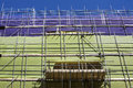 Scaffolding with protection nets green and purple Stock Images