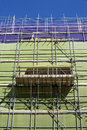 Scaffolding with protection nets green and purple Royalty Free Stock Photos