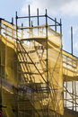 Scaffolding with protection nets yellow net it looks like a castle Royalty Free Stock Photos
