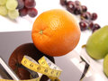 Scale with fresh fruits orange on a Stock Image