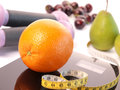 Scale with fresh fruits orange on a Stock Photography