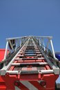 Scale up a ladder of firefighters during an emergency to save the citizens Stock Photos