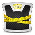 Scales diet concept measuring tape wrapped around bathroom of weight loss healthy lifestyle Royalty Free Stock Image