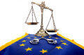 Scales of justice and european union flag handcuffs law concept Stock Image