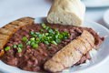 Scallions on red beans and rice sausage with topped with green french bread Stock Images