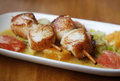 Scallop seafood close up appetizer with with oranges and grapefruits Stock Image
