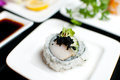 Scallop sushi roll on plate with black roe Stock Photos
